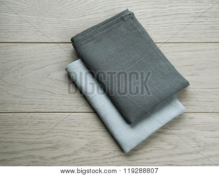 Grey Towels Pile Isolated On Wooden Background