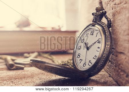 Vintage Antique pocket watch on old wooden surface