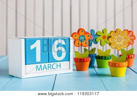 March 16th. Image of march 16 wooden color calendar with flower on white background.  Spring day