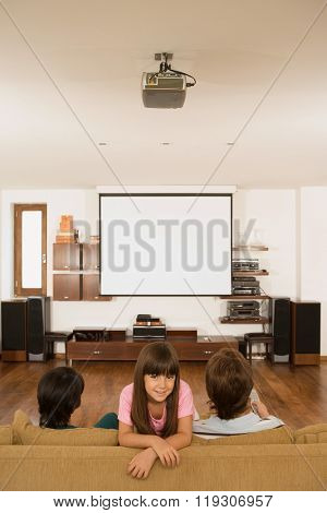 Girl and parents in living room
