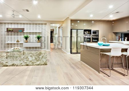 Closeup Of A Modern Kitchen And Living Room With Lights On