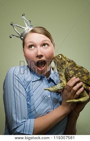 Office worker holding a frog