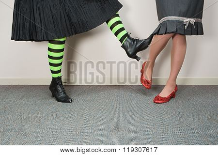 Woman kicking another woman
