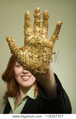 Woman with glitter on hand