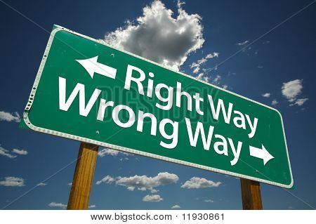 """""""Right Way, Wrong Way"""" Road Sign with dramatic blue sky and clouds."""