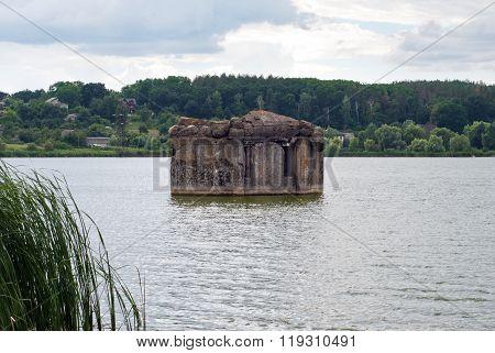 Evening lake and old pillbox near kiev