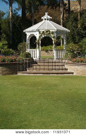 Elegant Wedding Gazebo with Steps and Lush Grass.
