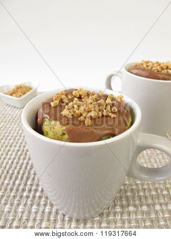 Mug Cake with chocolate icing and almond brittle