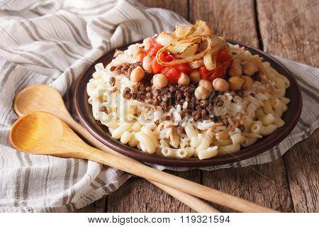 Arabic Cuisine: Kushari Of Rice, Pasta, Chickpeas And Lentils Close Up