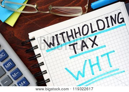 Whithholding tax WHT concept  written in a notebook.