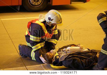 CZECH REPUBLIC, PLZEN,  30 SEPTEMBER,  2015:Brave firefighter relieve  an injured after car accident