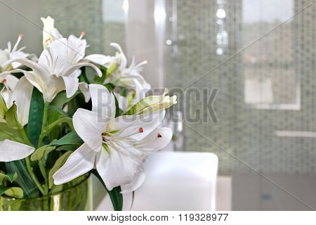 Bunch Of White Flowers On The Glass Of A Room With Blurred Background