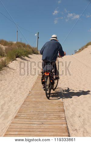 Man Riding Bikes On The Ocean