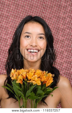 Woman holding bunch of lilies