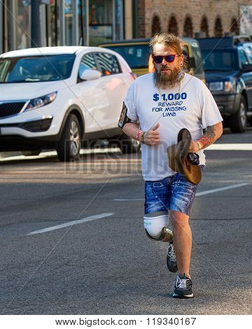Boise, Idaho/usa February 13, 2016: Man Who Lost His Leg Due To Neurofibromatosis Running At The Cup