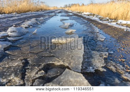 Dirt Road With Melting Ice