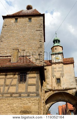 Rothenburg ob der Tauber one of the best-preserved medieval towns in Germany. Markus Tower with Roder arch with its slim clock tower which were part of the town's first fortifications (1200). poster