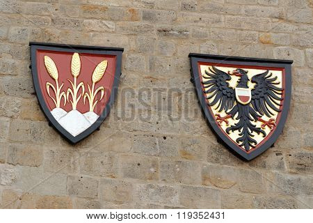 Left - the coat of arms of the free city of Dinkelsbuhl an old medieval town in Germany; Right - the imperial coat of arms.
