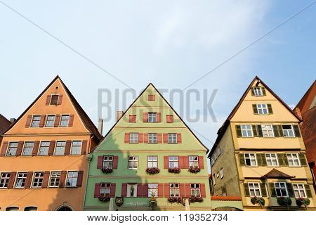 DINKELSBUHL GERMANY - AUGUST 10 2015: Traditional architecture in Dinkelsbuhl one of the best-preserved medieval towns in Europe part of the famous Romantic Road tourist route.