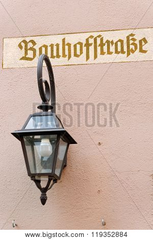 Old street sign of Bauhof street in Dinkeslbuhl one of the best-preserved medieval towns in Europe part of the famous Romantic Road tourist route in Germany.