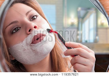 girl shaves in mirror