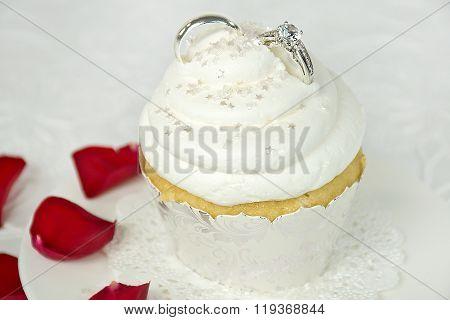 wedding rings on cupcake