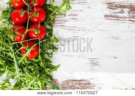 Eruca Sativa, Rucola, And Baby Tomatoes, Fresh Green Salad Leaves Copyspace Background  Isolated Ove