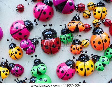 Lots Of Colorful Wooden Ladybugs.