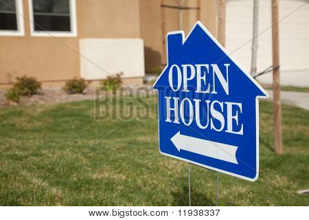Blue Open House Real Estate Sign in Front Yard of Home.