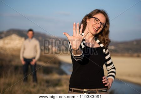 Couple In Love On Engagement Day In Natural Park.