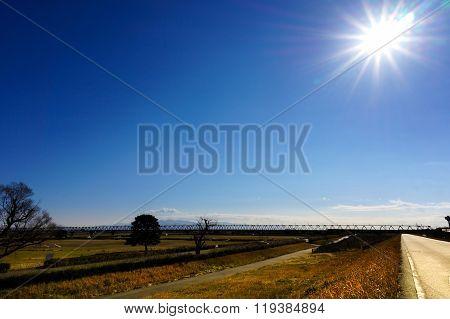Meadow Landscape, Railway Bridge And Sunny Sky