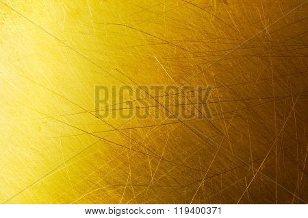 Brushed and scratched golden metal background or texture