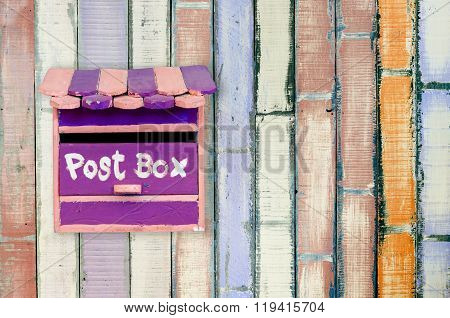 wooden postbox with old wooden background