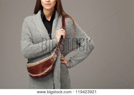 Elegant Model In Gray Woven Cardigan With A Leather Fanny Pack.