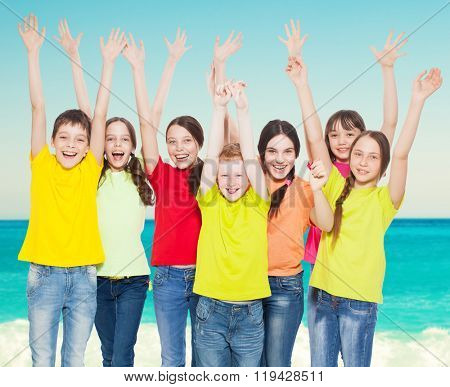 Happy group children at sea. Smiling teen. Frendship boys and girls