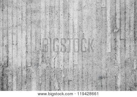 Gray Concrete Wall With Relief Pattern Of Timber