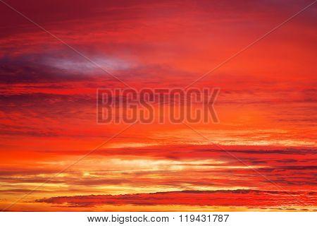 Fiery orange sunset sky. Apocalyptic sunset sky