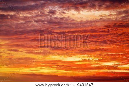 Fiery orange sunset sky. Beautiful apocalyptic sunset sky.