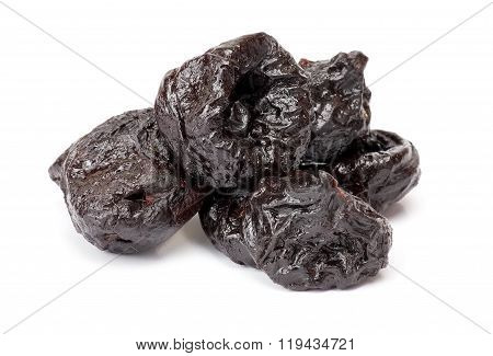 Dried plum - prunes isolated on a white background. Black dry prunes