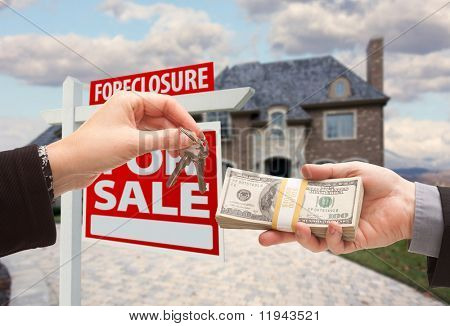 Handing Over Cash For House Keys in Front of House and Foreclosure Sign. poster