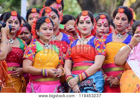 KOLKATA INDIA - MARCH 5 2015 : Young girl dancers waiting to perform at Holi / Spring festival known as Dol (in Bengali) or Holi (in Hindi) celebrating arrival of Spring in India. A very popular festival amongst Bengalis.