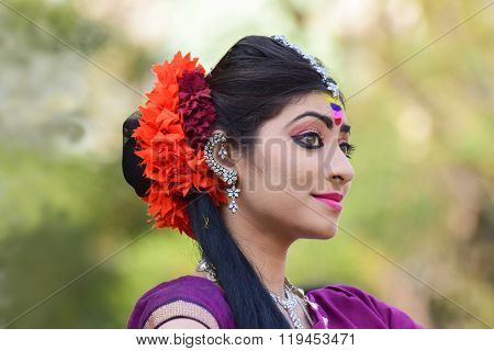 KOLKATA INDIA - MARCH 5 2015 : Young girl dancers performing at Holi / Spring festival known as Dol (in Bengali) or Holi (in Hindi) celebrating arrival of Spring in India. A very popular festival amongst Bengalis.