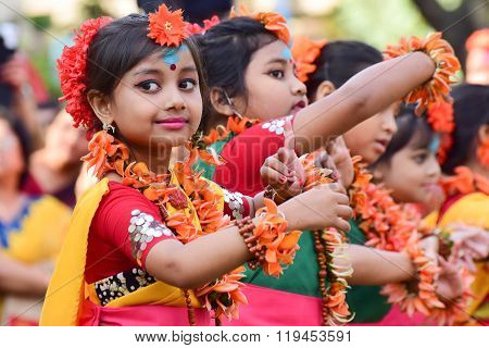 KOLKATA INDIA - MARCH 5 2015 : Girl child dancers performing at Holi / Spring festival known as Dol (in Bengali) or Holi (in Hindi) celebrating arrival of Spring in India. A very popular festival amongst Bengalis.