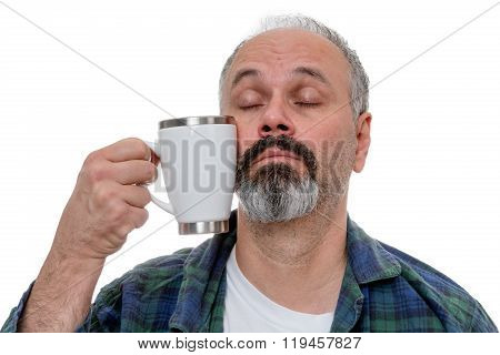 Sleepy Man Struggling To Drink Coffee