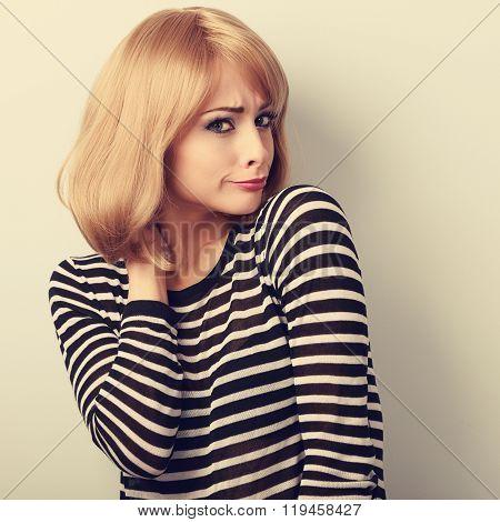 Displeased Suspicious Blond Woman Looking Skeptical. Toned Closeup Portrait