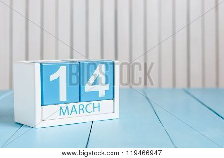 March 14th. Image of march 14 wooden color calendar with flower on white background.  Spring day.  C
