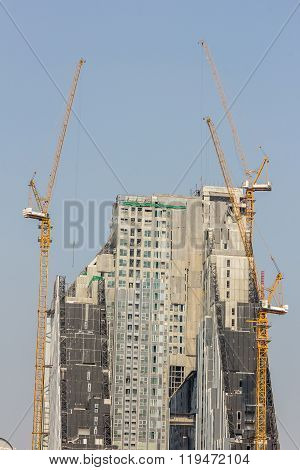 Inside Place For Many Tall Buildings Under Construction And Cranes Under A Blue Sky