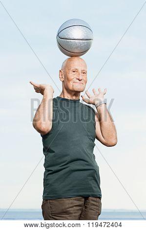 Man balancing basketball on his head