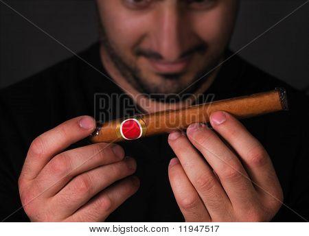 Man admiring cigar