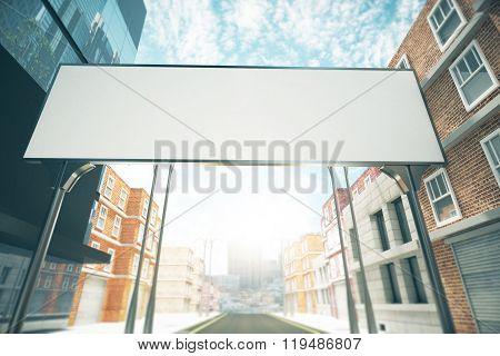 Big blank billboard over the road between buildings mock up poster